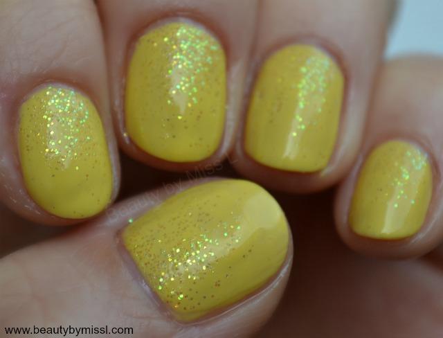 yellow glitter manicure