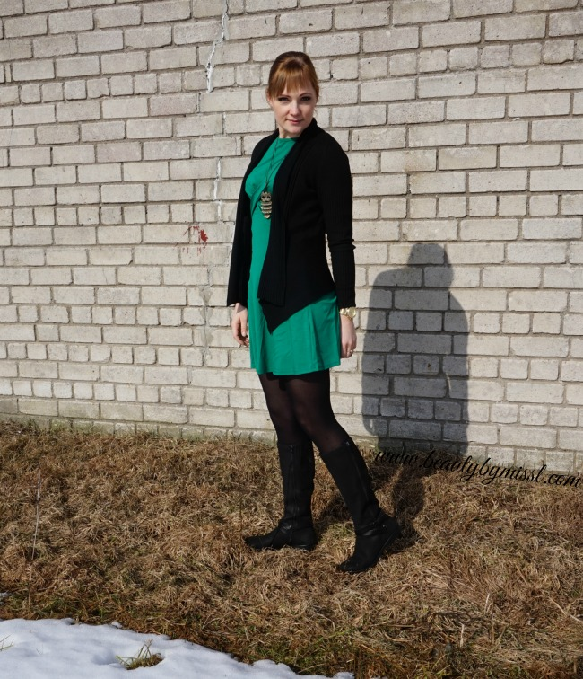 green dress, black cardigan and boots