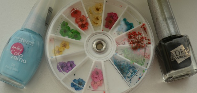 nail polishes and dried flowers