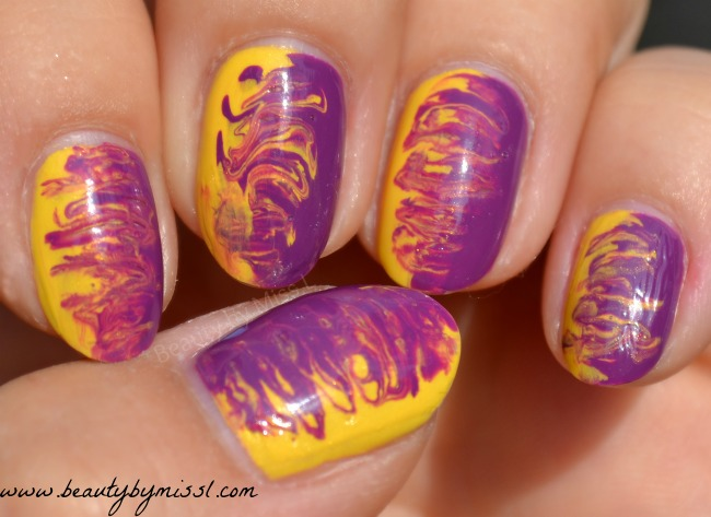purple and yellow manicure with avon gel finish nail polishes