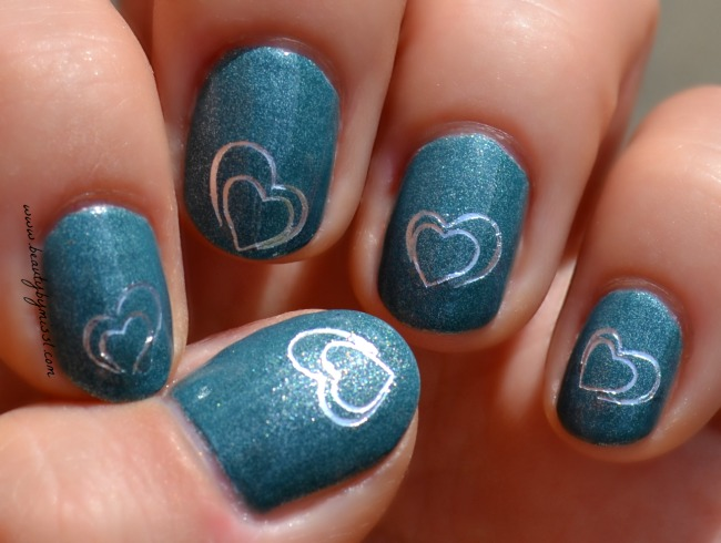 simple manicure with heart shaped water decals