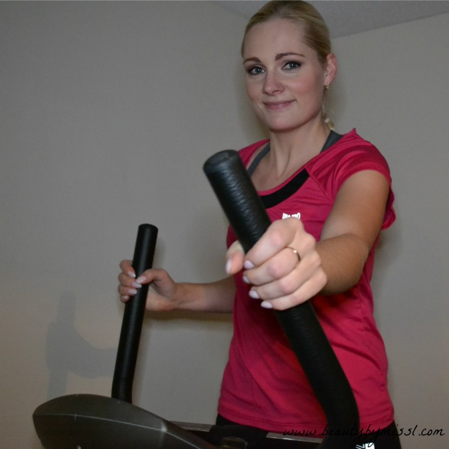 working out on cross trainer