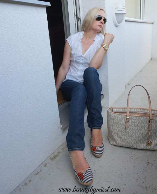 blue jeans and white blouse