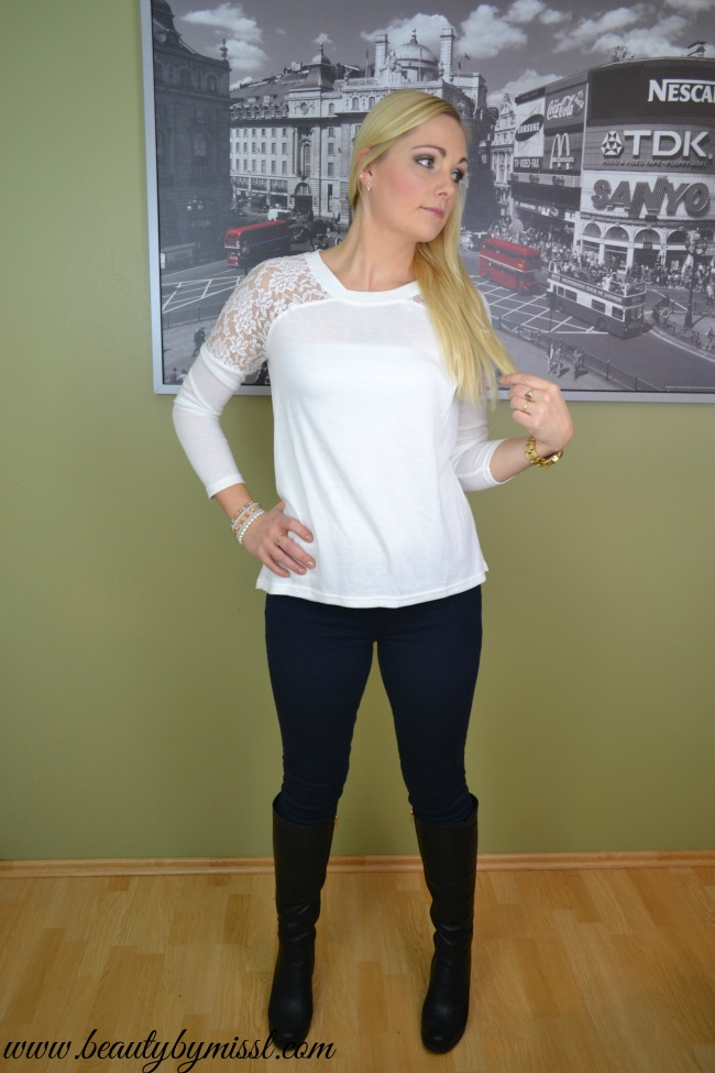 white lace detail top and dark blue jeans