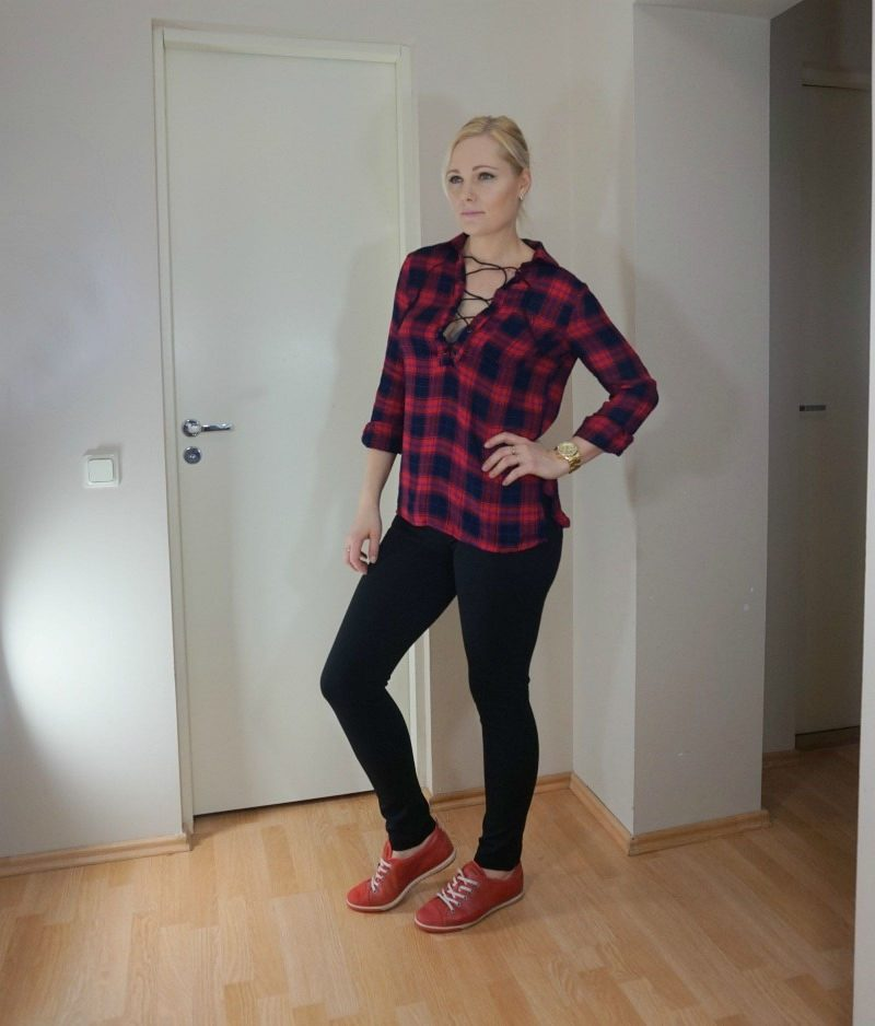 red plaid blouse, black pants, red shoes