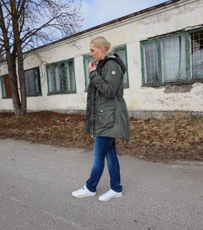 Striped top, jeans, white sneakers and winter parka & link up
