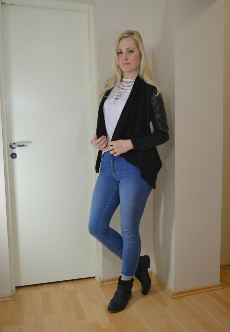 white lace up tee, black vegan leather jacket, blue jeans, black ankle boots