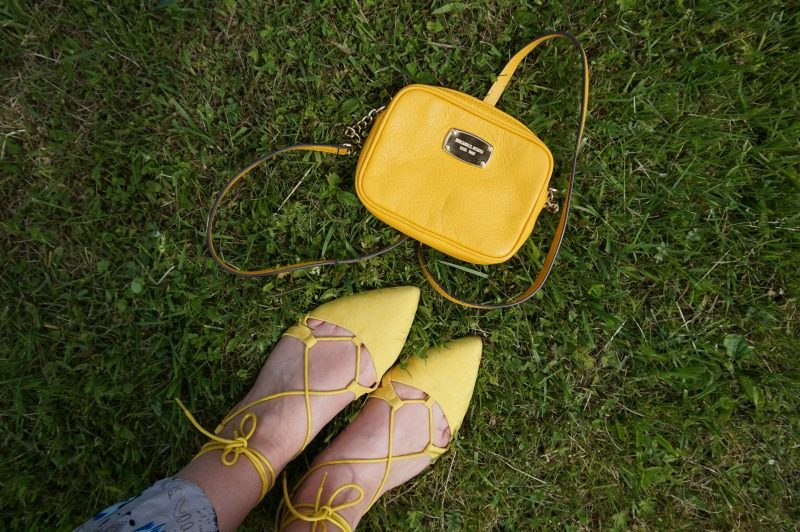 yellow lace-up flats and Michael Kors cross body bag
