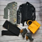 camouflage tee black vegan leather jacket black pants heeled booties yellow bag