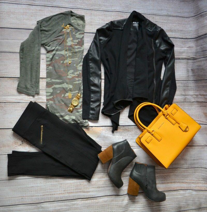 camouflage tee black vegan leather jacket black pants heeled booties yellow bag
