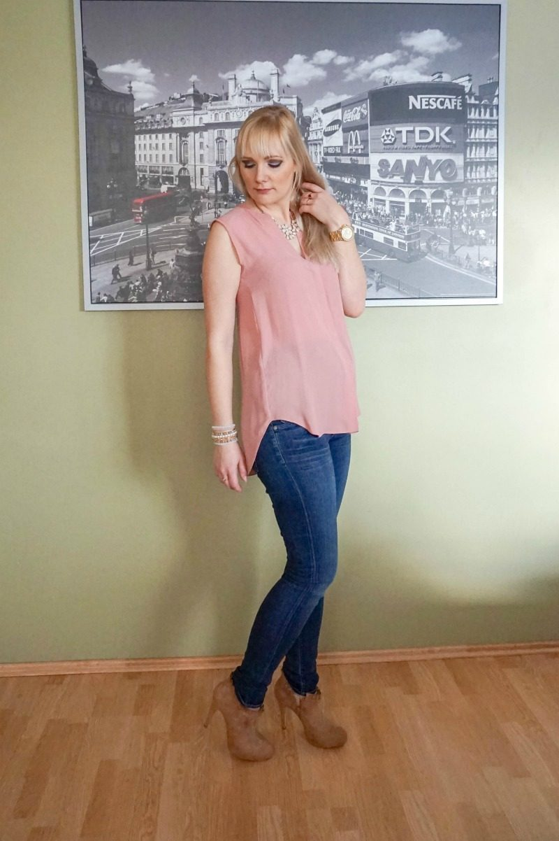 blush top dark blue jeans