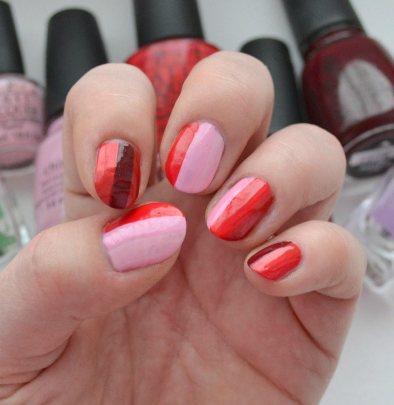 red and pink striped nails
