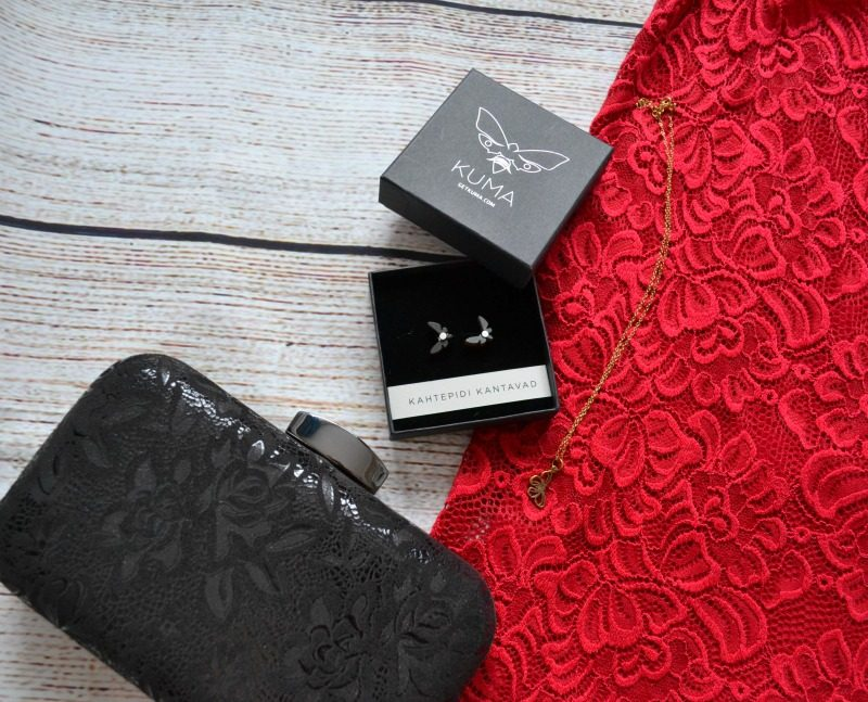 Kuma earrings, Lily Charmed necklace, Lotus clutch bag