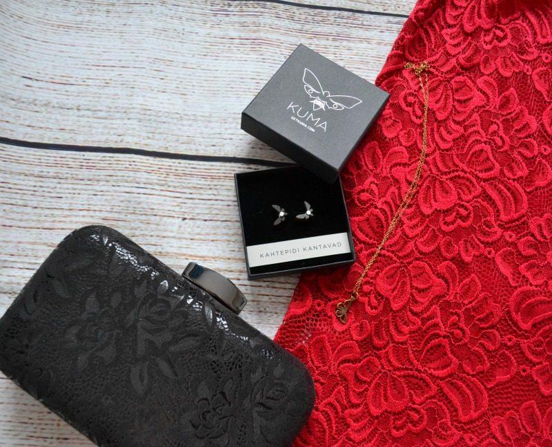 Kuma earrings, Lily Charmed necklace, Lotus clutch bag