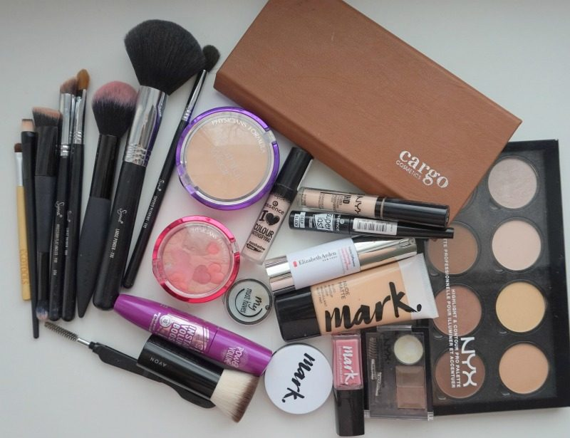 makeup products and brushes from NYX, Cargo Cosmetics, Elizabeth Arden, Avon, Essence Cosmetics, Physicians Formula