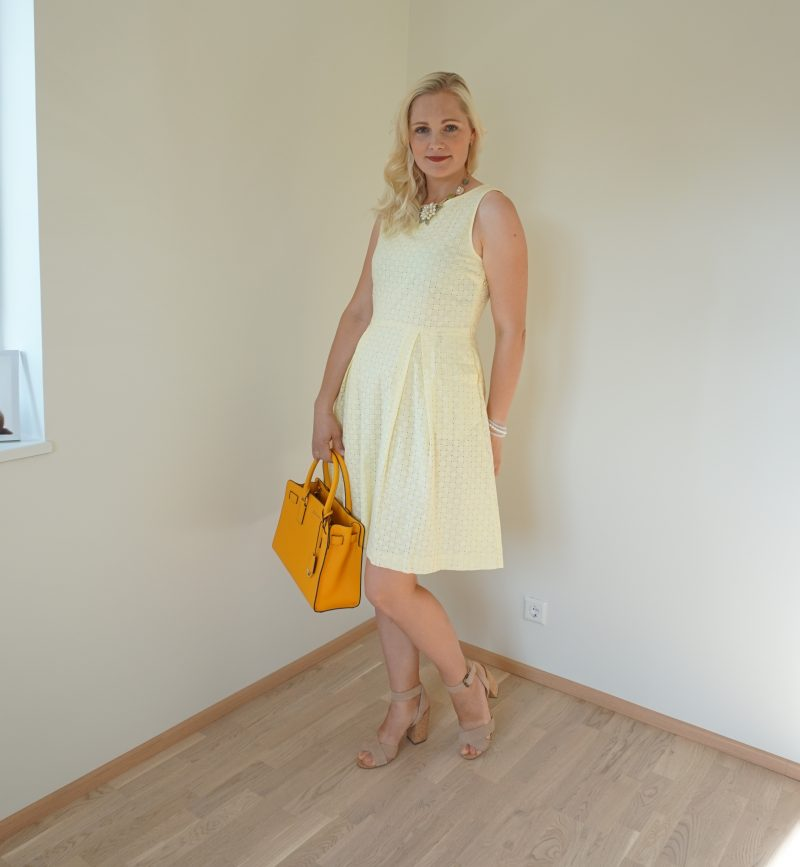 yellow dress and yellow handbag