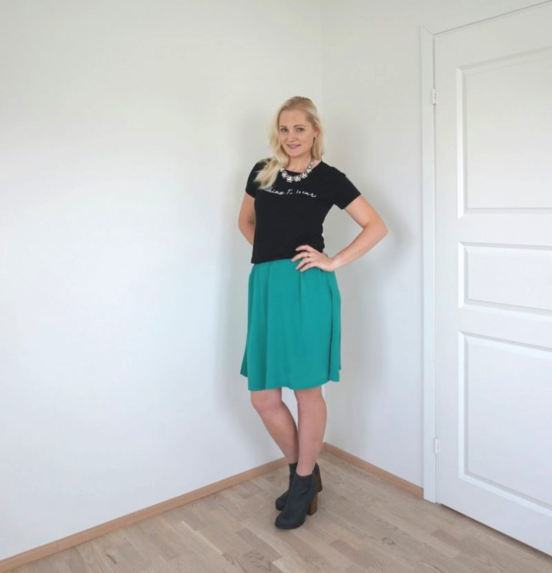 green skirt and black t-shirt outfit