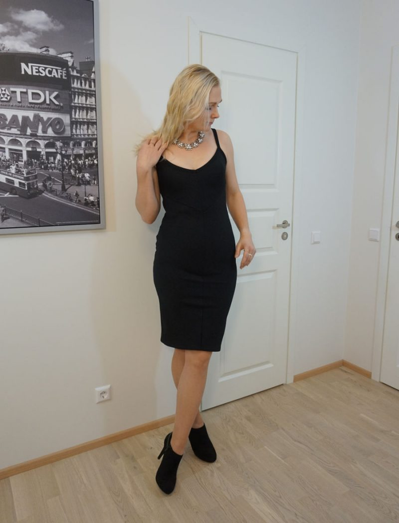 Black bodycon dress and black heeled ankle booties