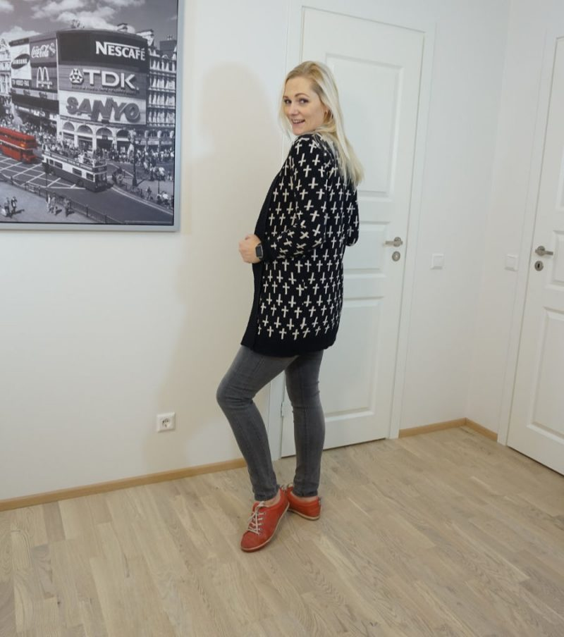red shoes and black and grey outfit