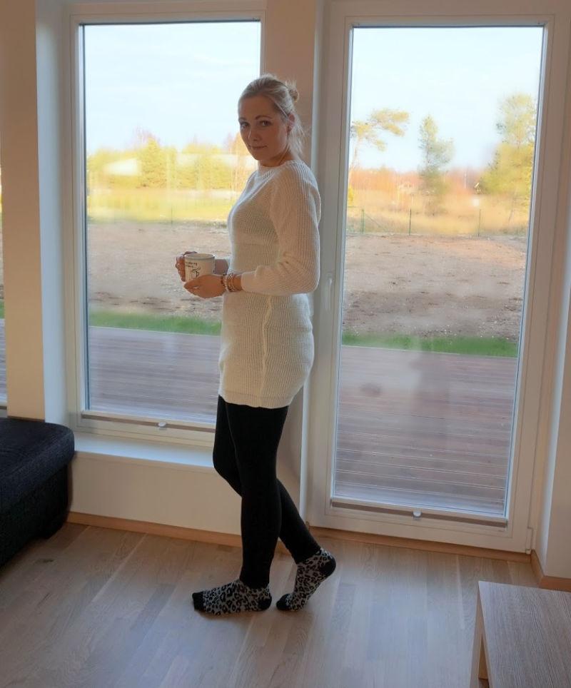 white knitted mini dress and black leggings