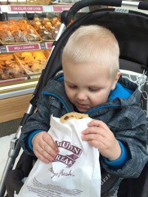 kid enjoying biscuit while travelling in the UK