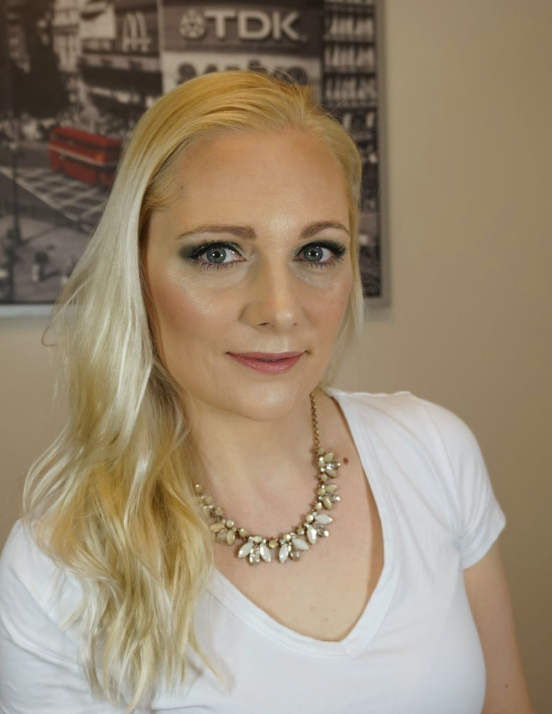 blonde hair and green eye makeup