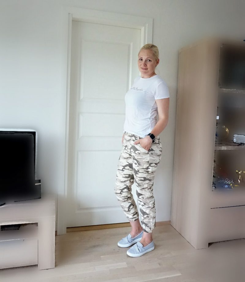 camouflage trousers and striped shoes