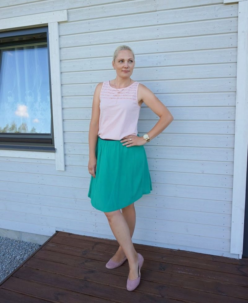 green skirt and peach top outfit