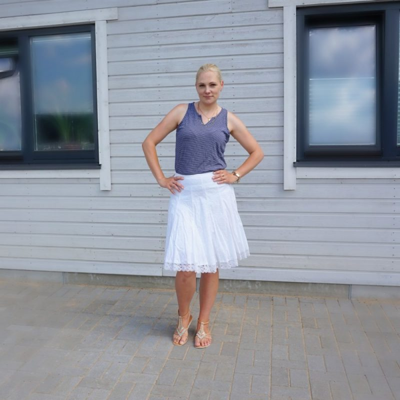 hole-emroidered skirt with a navy-white striped top