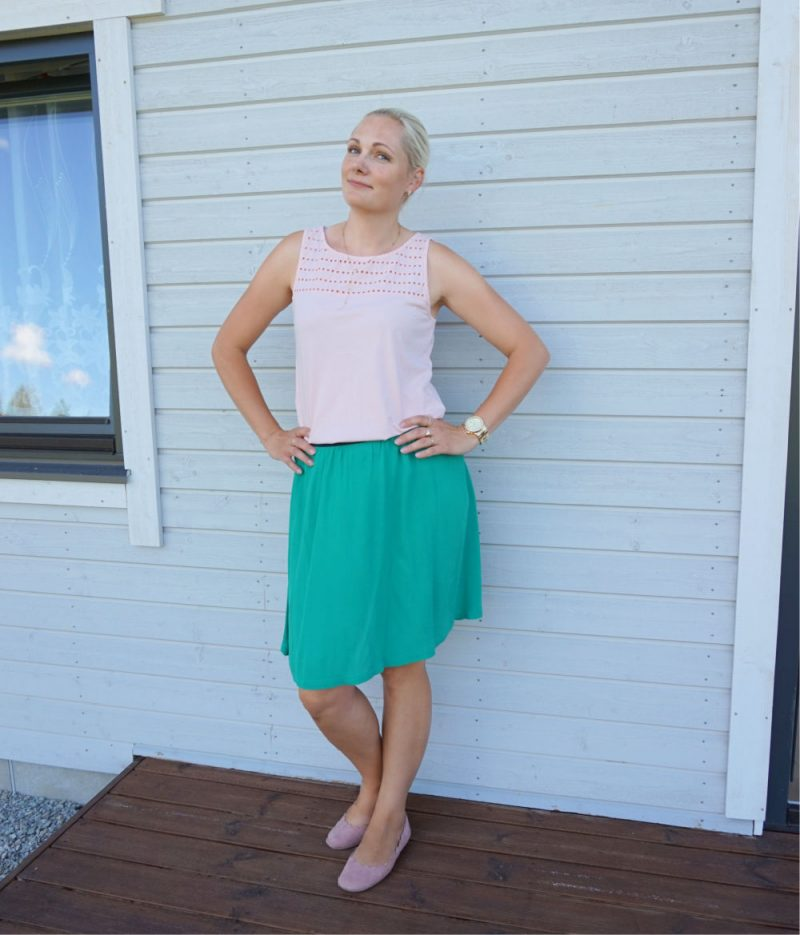 light pastel peach top and green skirt