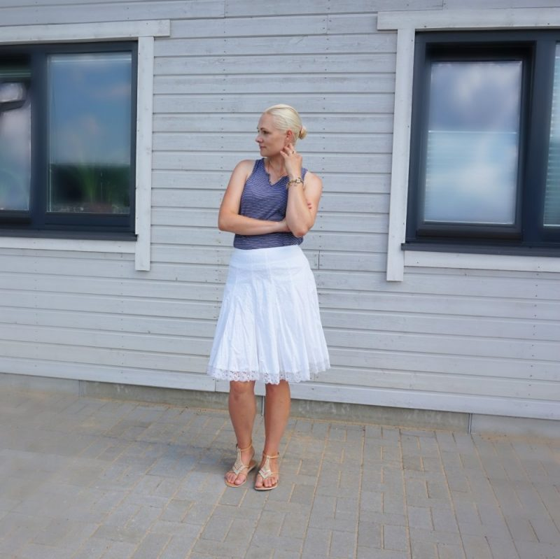 white knee-length skirt and navy-white striped top