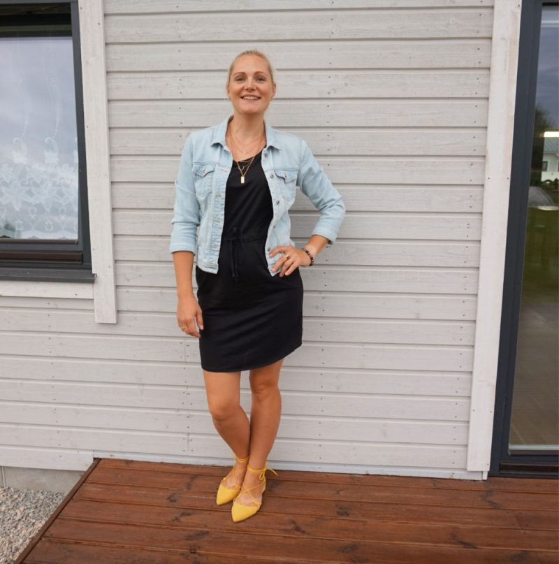 black mini dress yellow shoes light blue jacket