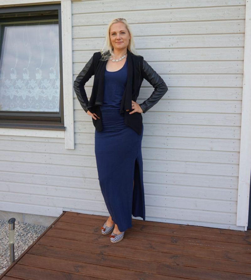 navy blue maxi dress and black vegan leather jacket