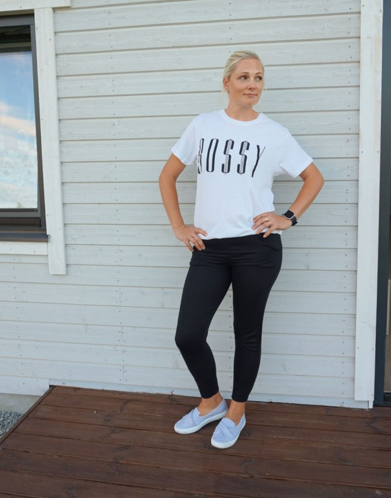 white Bossy t-shirt and black joggers