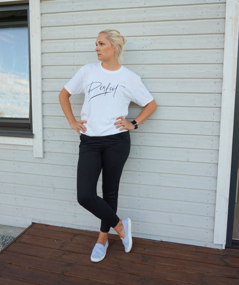 white oversized t-shirt and black joggers from Femme Luxe