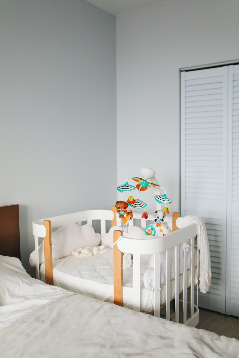 white crib in a bedroom
