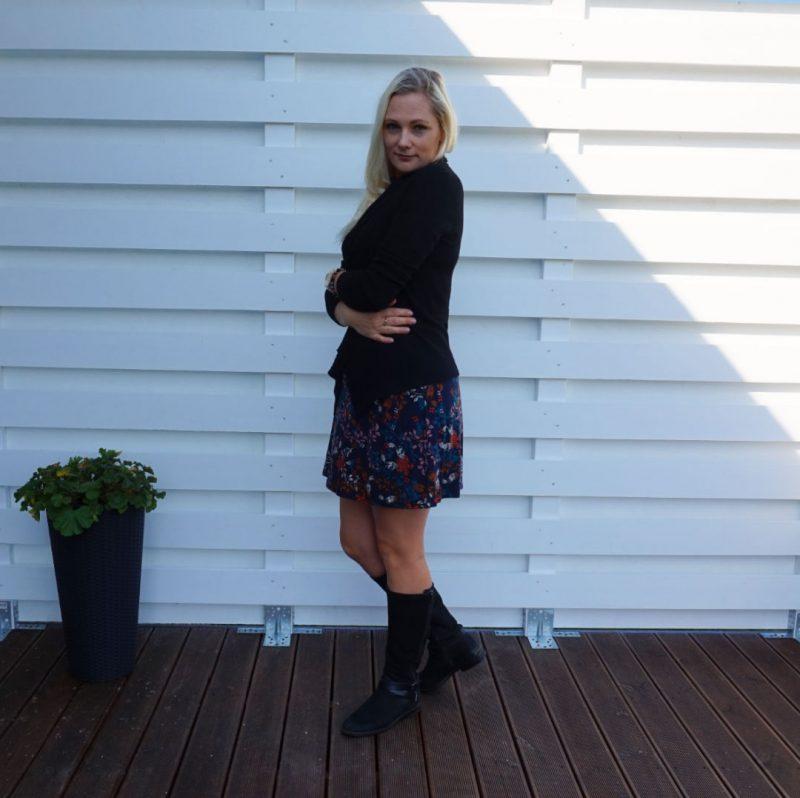 black cardigan black boots floral dress