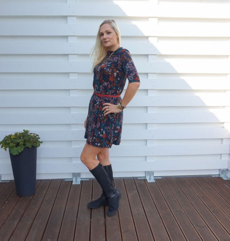 floral a-line mini dress and black boots outfit