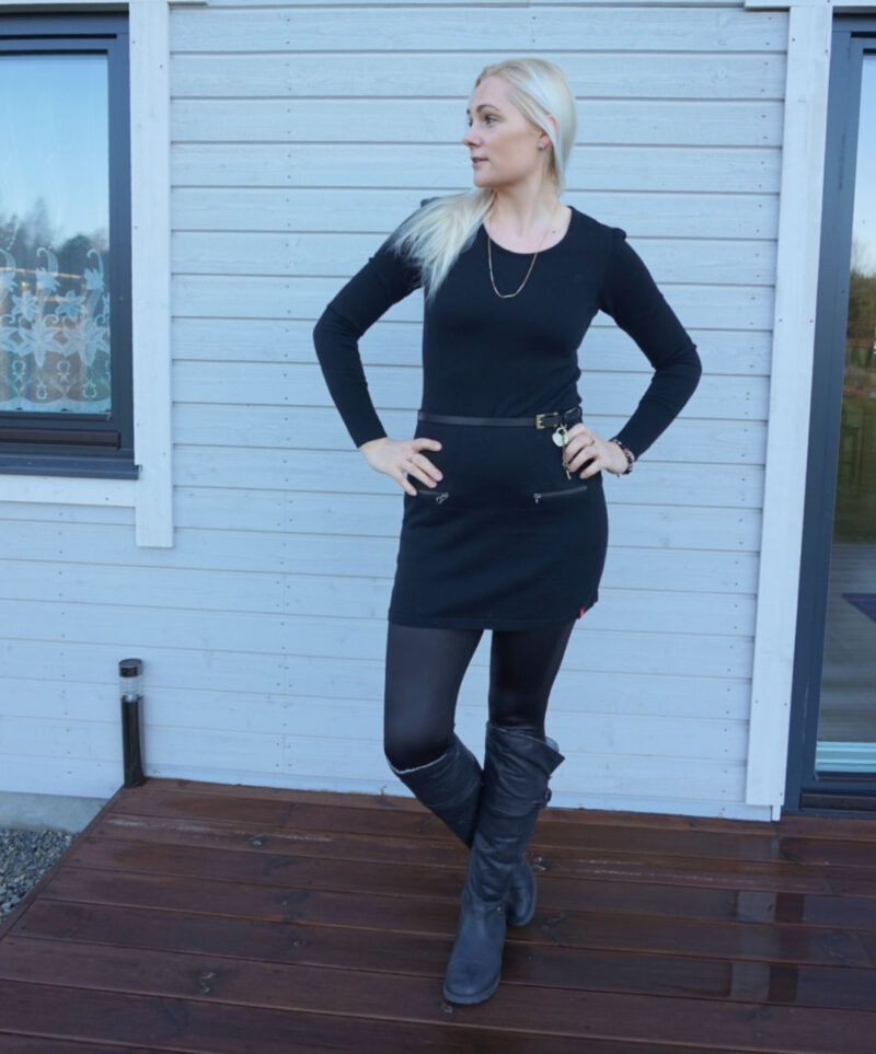 black jumper dress and black wet look leggings with black knee-high boots