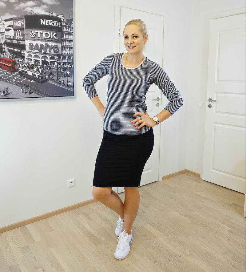 black skirt striped top white sneakers