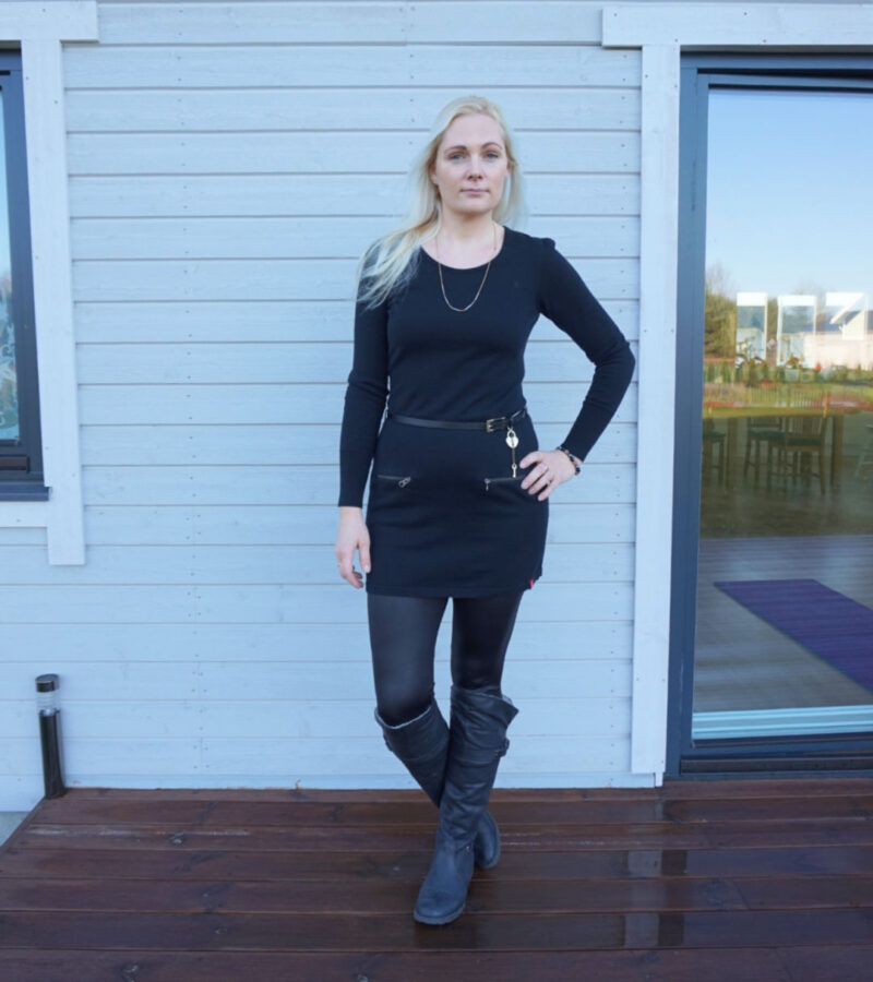 black mini dress with long sleeves and black leggings with knee-high boots