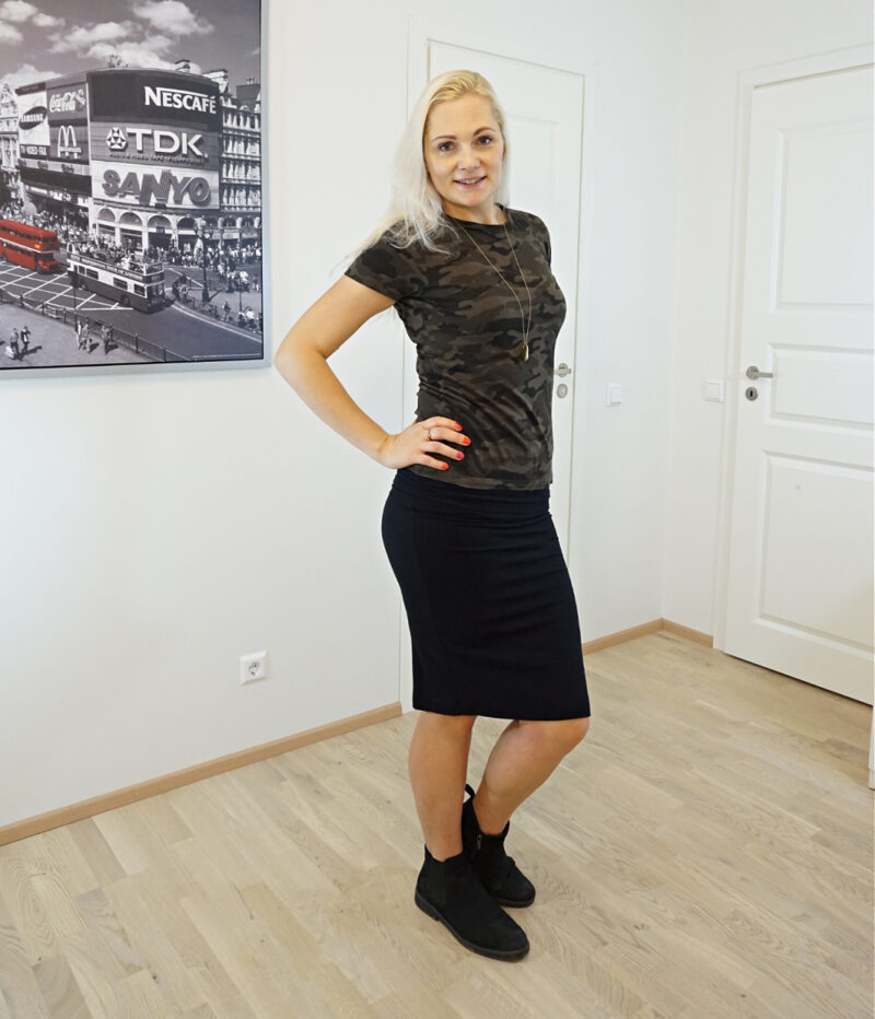 camouflage tee and black skirt