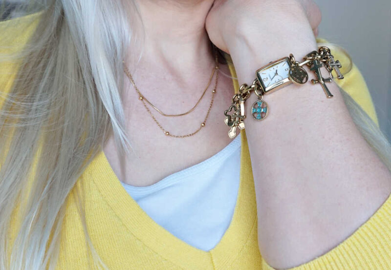 cross charm watch and layered necklace