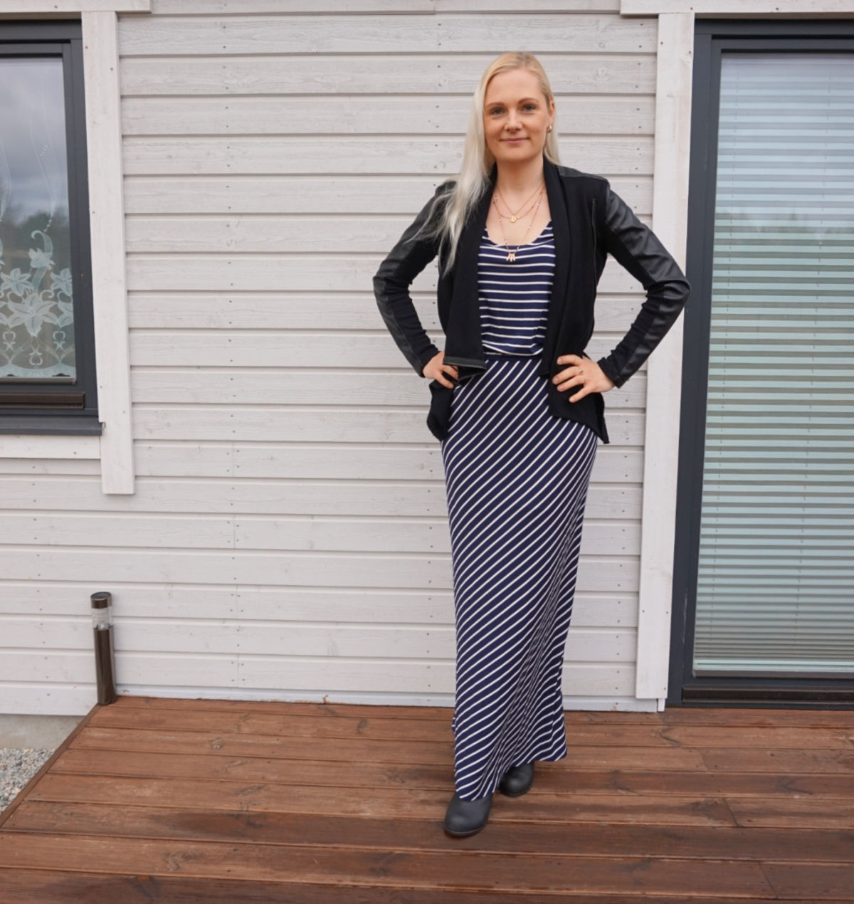 Striped maxi dress and black vegan leather and ponte jacket outfit for spring 2021.