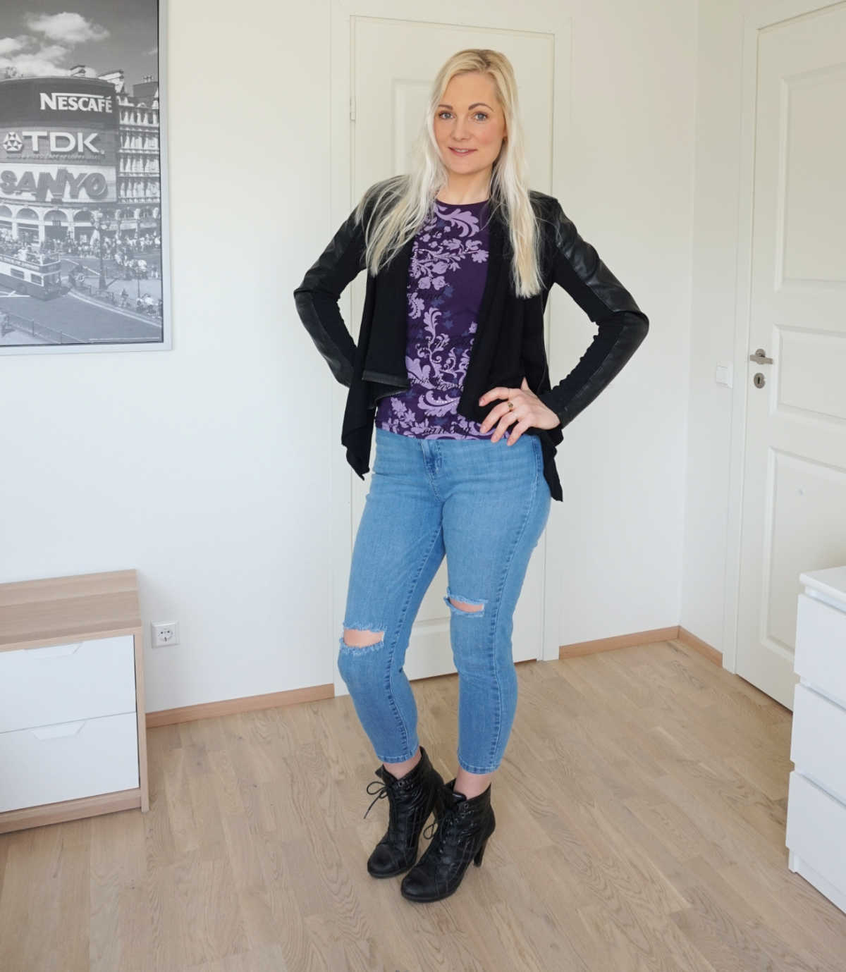 Simple casual outfit: rhinestones embellished purple t-shirt, black vegan leather and ponte jacket, light blue ripped skinny jeans and black heeled ankle boots.