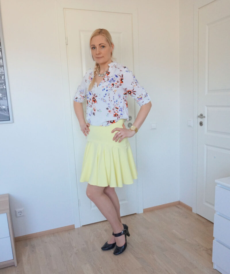yellow skirt with drop peplum hem and floral long-sleeve blouse
