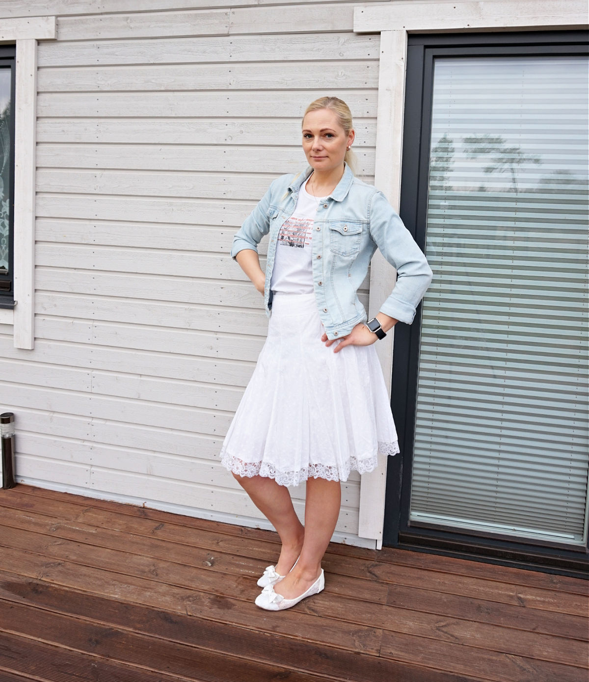 Simple white on white outfit with a touch of light blue