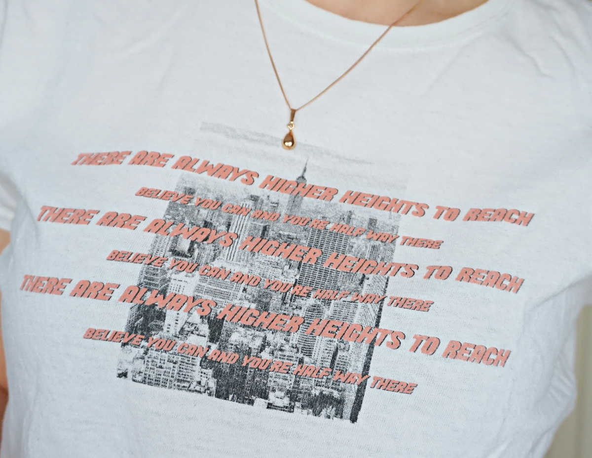 Daisy Street graphic t-shirt and gold necklace