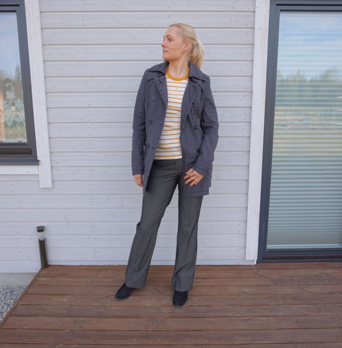 Simple outfit for spring - grey checkered coat, yellow white striped t-shirt, grey dressy pants and black ankle boots.