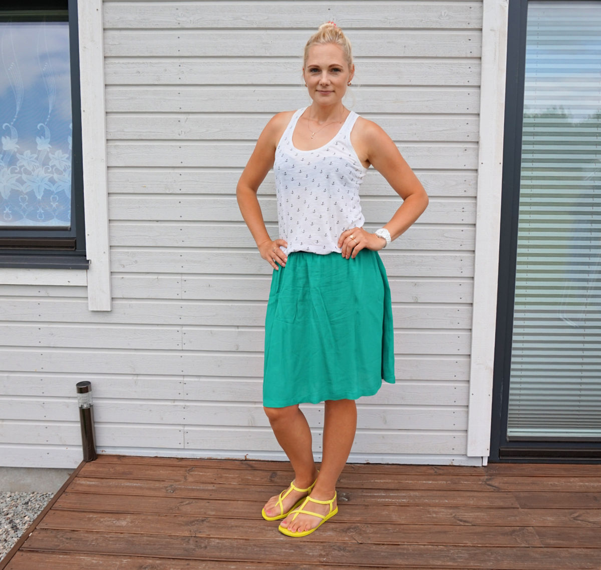 Simple summer outfit: white racerback top, green skirt and yellow sandals.